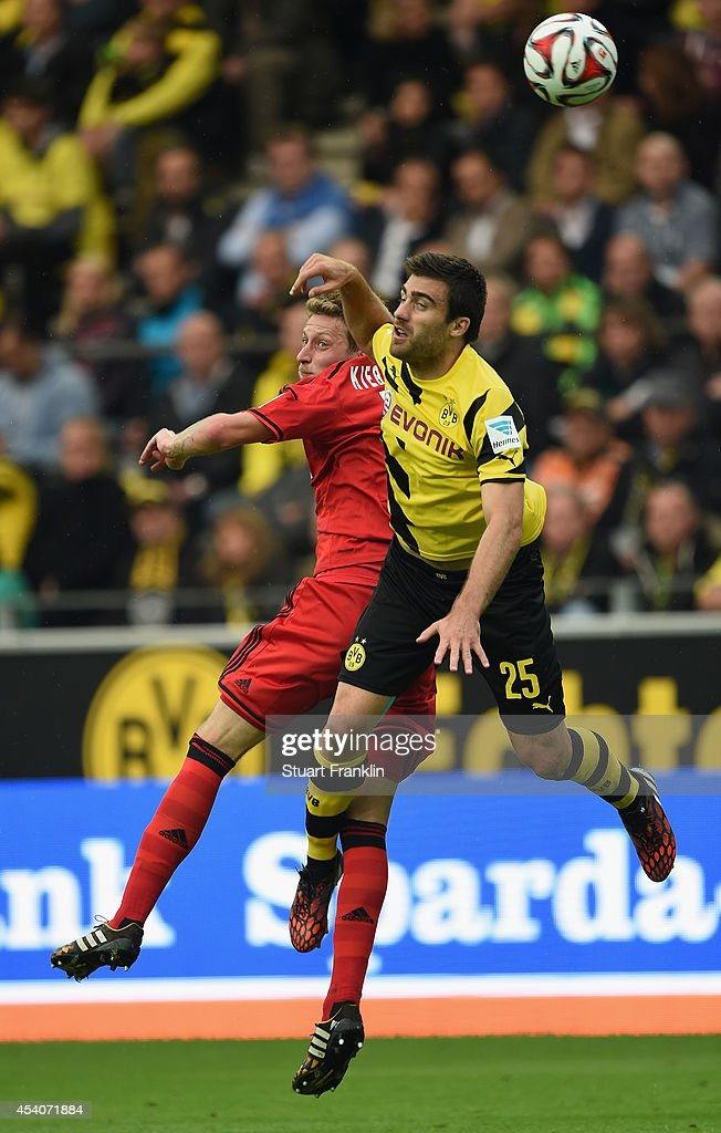 Sokratis of Dortmund is challenged by <a gi-track='captionPersonalityLinkClicked' href=/galleries/search?phrase=Stefan+Kiessling&family=editorial&specificpeople=605405 ng-click='$event.stopPropagation()'>Stefan Kiessling</a> of Leverkusen during the Bundesliga match between Borussia Dortmund and Bayer 04 Leverkusen at Signal Iduna Park on August 23, 2014 in Dortmund, Germany.