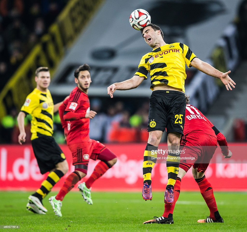 Sokratis of Dortmund jumps for a header with <a gi-track='captionPersonalityLinkClicked' href=/galleries/search?phrase=Stefan+Kiessling&family=editorial&specificpeople=605405 ng-click='$event.stopPropagation()'>Stefan Kiessling</a> of Leverkusen during the Bundesliga match between Bayer Leverkusen and Borussia Dortmund at BayArena on January 31, 2015 in Leverkusen, Germany.