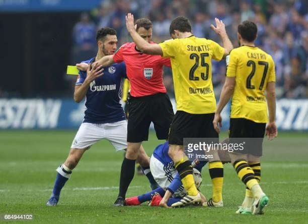 Sokratis of Dortmund Leon Goretzka of Schalke and Referee Felix Zwayer in action during the Bundesliga match between FC Schalke 04 and Borussia...