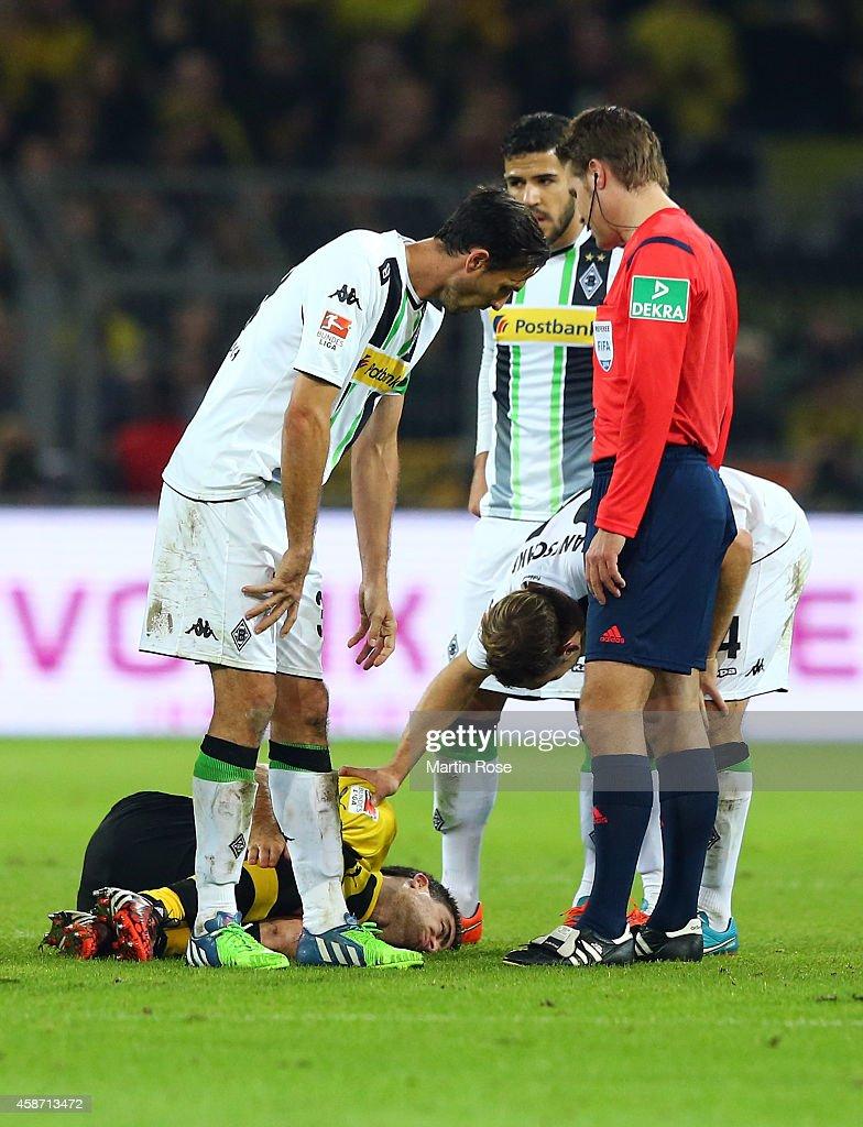 Sokratis of Dortmund lies injured on the pitch during the Bundesliga match between Borussia Dortmund and Borussia moenchengladbach at Signal Iduna Park on November 9, 2014 in Dortmund, Germany.
