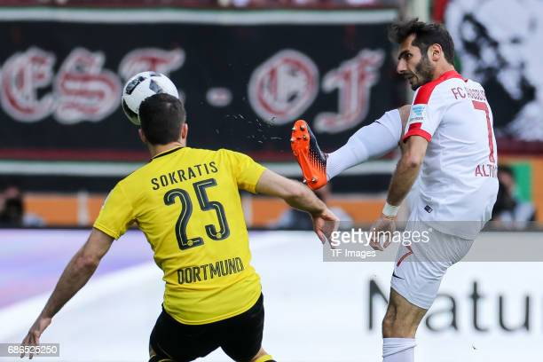 Sokratis of Dortmund und Halil Altintop of Augsburg battle for the ball during the Bundesliga match between FC Augsburg and Borussia Dortmund at the...