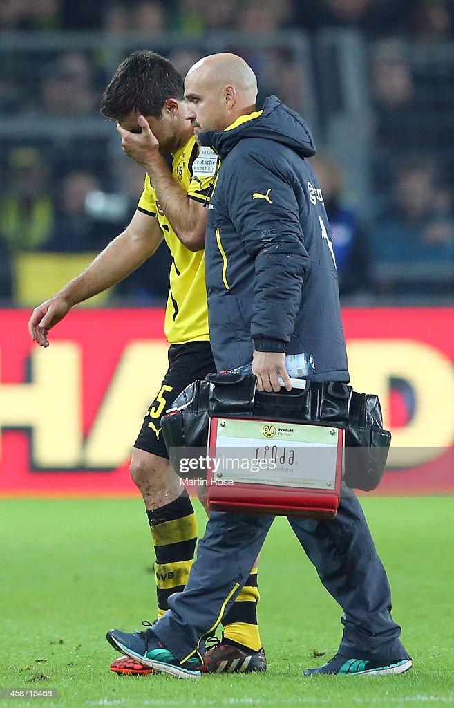 Sokratis of Dortmund walks injured off the pitch during the Bundesliga match between Borussia Dortmund and Borussia moenchengladbach at Signal Iduna Park on November 9, 2014 in Dortmund, Germany.