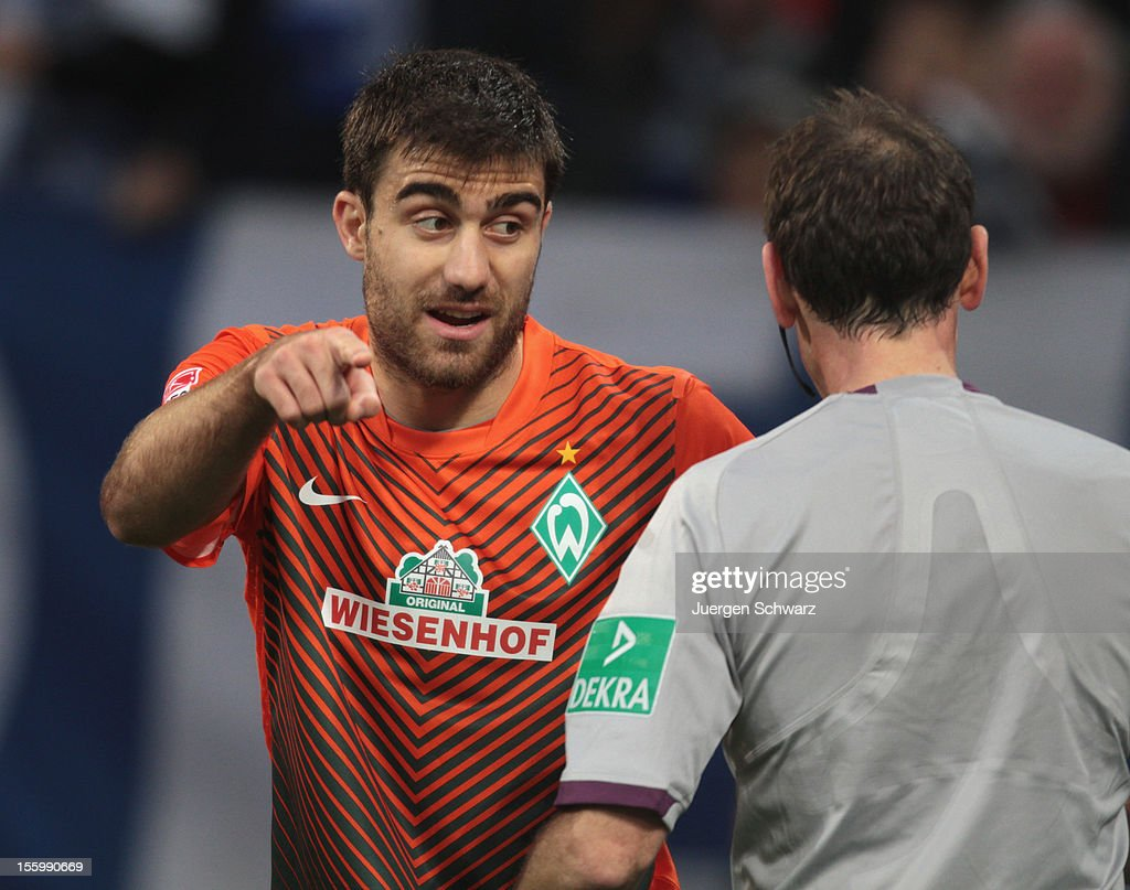Sokratis of Werder gestures in front of referee Florian Meyer during the Bundesliga match between FC Schalke 04 and Werder Bremen at Veltins-Arena on November 10, 2012 in Gelsenkirchen, Germany.
