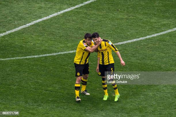 Sokratis Papastathopoulos and Marc Bartra of Dortmund react after the Bundesliga match between FC Schalke 04 and Borussia Dortmund at VeltinsArena on...