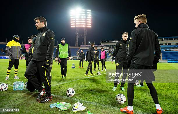 Sokratis Papastathopoulos Lukasz Piszczek and Marco Reus of Dortmund during a training session at Petrovsky Stadium on February 24 2014 in Saint...