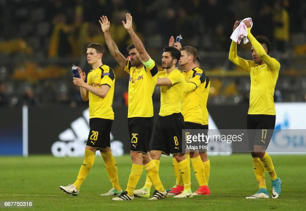 Sokratis Papastathopoulos of Borussia Dortmund applauds the fans with team mates after the UEFA Champions League Quarter Final first leg match...