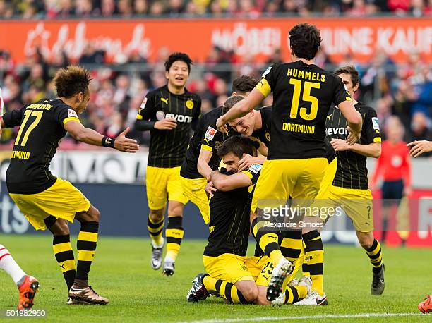Sokratis Papastathopoulos of Borussia Dortmund celebrates after scoring the opening goal with his team mates during the Bundesliga match between 1 FC...