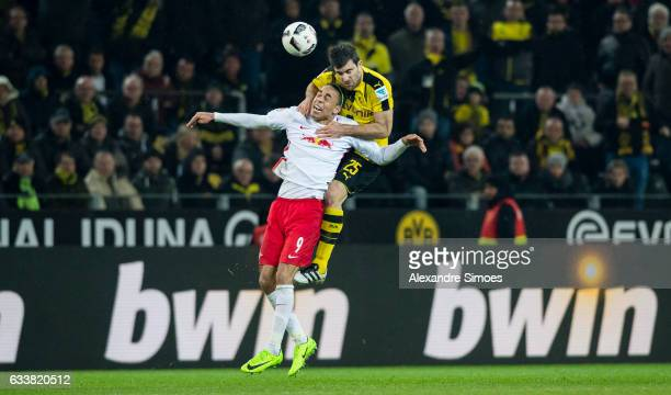 Sokratis Papastathopoulos of Borussia Dortmund challenges Yuffuf Poulsen of RB Leipzig during the Bundesliga match between Borussia Dortmund and RB...