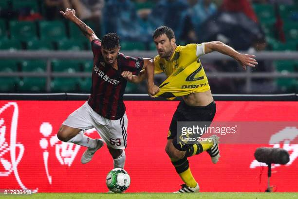 Sokratis Papastathopoulos of Borussia Dortmund competes for the ball with Patrick Cutrone of AC Milan during the 2017 International Champions Cup...