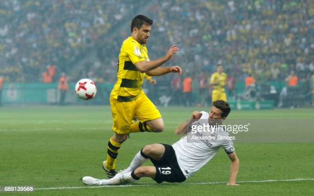 Sokratis Papastathopoulos of Borussia Dortmund gets challenged by David Abraham of Eintracht Frankfurt during the DFB Cup Final match between...