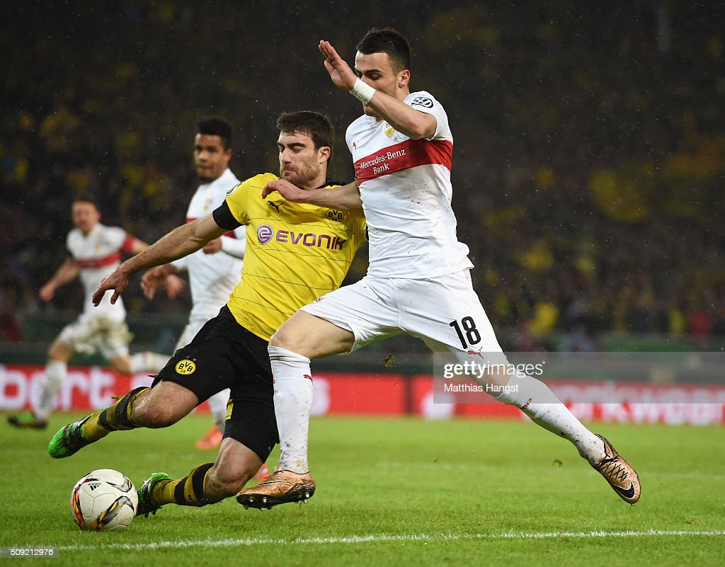 <a gi-track='captionPersonalityLinkClicked' href=/galleries/search?phrase=Sokratis+Papastathopoulos+-+Soccer+Player&family=editorial&specificpeople=4426771 ng-click='$event.stopPropagation()'>Sokratis Papastathopoulos</a> of Borussia Dortmund tackles Filip Kostic of Stuttgart during the DFB Cup Quarter Final match between VfB Stuttgart and Borussia Dortmund at Mercedes-Benz Arena on February 9, 2016 in Stuttgart, Germany.