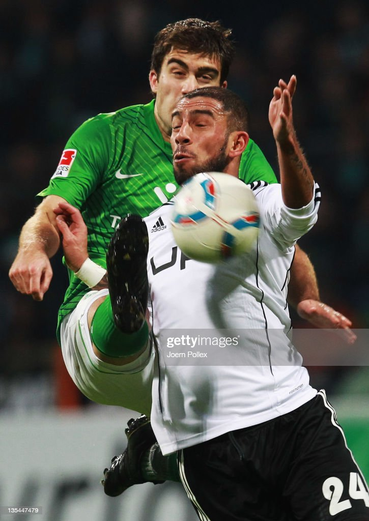 <a gi-track='captionPersonalityLinkClicked' href=/galleries/search?phrase=Sokratis+Papastathopoulos+-+Soccer+Player&family=editorial&specificpeople=4426771 ng-click='$event.stopPropagation()'>Sokratis Papastathopoulos</a> (L) of Bremen and <a gi-track='captionPersonalityLinkClicked' href=/galleries/search?phrase=Ashkan+Dejagah&family=editorial&specificpeople=4024305 ng-click='$event.stopPropagation()'>Ashkan Dejagah</a> of Wolfsburg battle for the ball during the Bundesliga match between SV Werder Bremen and VfL Wolfsburg at Weser Stadium on December 10, 2011 in Bremen, Germany.