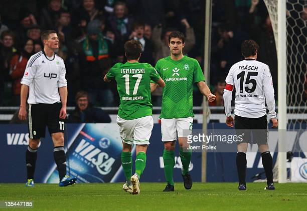 Sokratis Papastathopoulos of Bremen celebrates after scoring his team's first goal during the Bundesliga match between SV Werder Bremen and VfL...