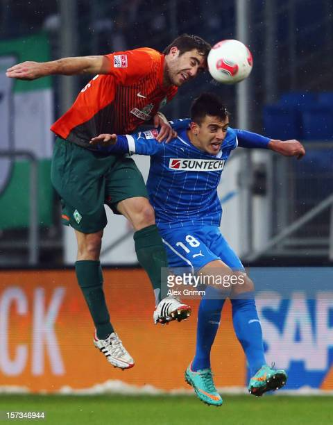 Sokratis Papastathopoulos of Bremen outjumps Joselu of Hoffenheim during the Bundesliga match between TSG 1899 Hoffenheim and SV Werder Bremen at...