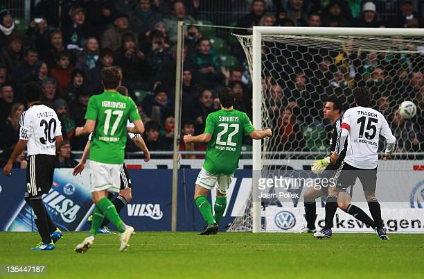 Sokratis Papastathopoulos of Bremen scores his team's first goal during the Bundesliga match between SV Werder Bremen and VfL Wolfsburg at Weser...