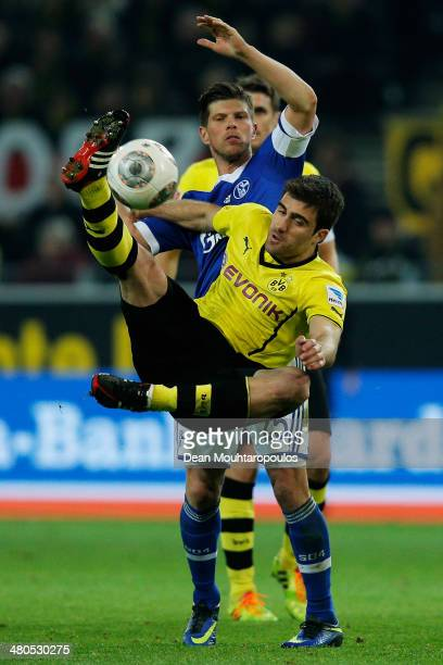 Sokratis Papastathopoulos of Dortmund and KlaasJan Huntelaar of Schalke 04 battle for the ball during the Bundesliga match between Borussia Dortmund...