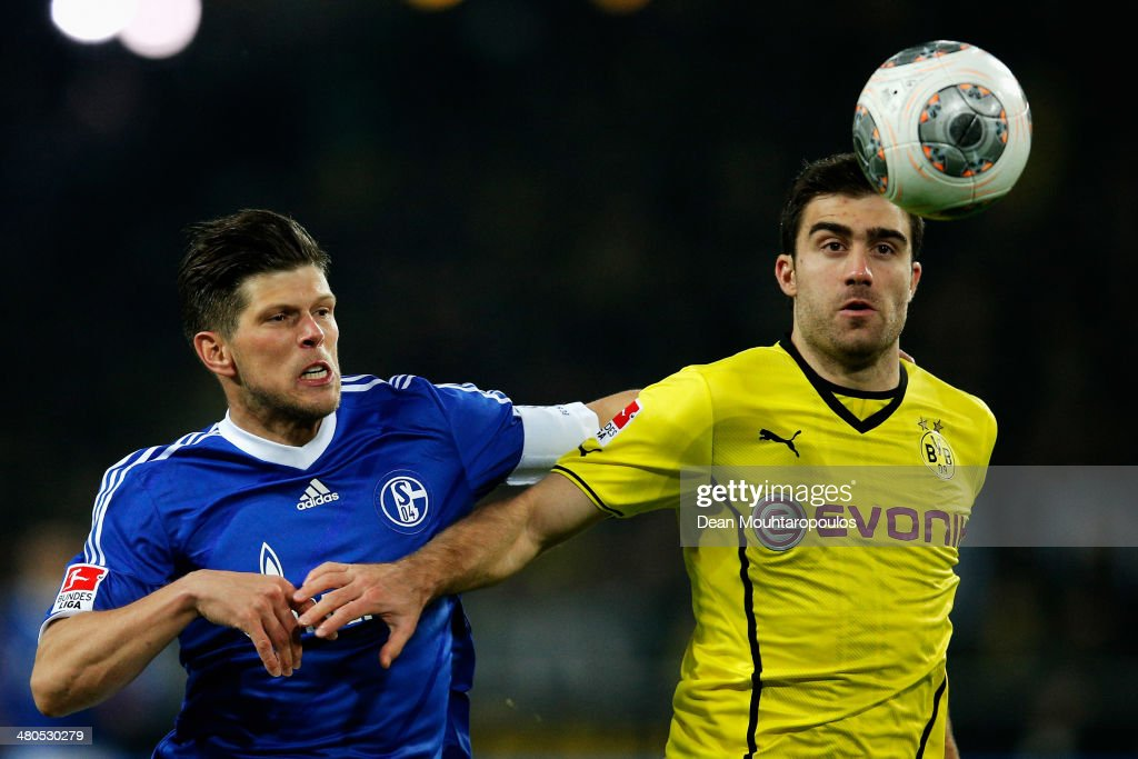 <a gi-track='captionPersonalityLinkClicked' href=/galleries/search?phrase=Sokratis+Papastathopoulos&family=editorial&specificpeople=4426771 ng-click='$event.stopPropagation()'>Sokratis Papastathopoulos</a> of Dortmund and Klaas-Jan Huntelaar of Schalke 04 battle for the ball during the Bundesliga match between Borussia Dortmund and FC Schalke at Signal Iduna Park on March 25, 2014 in Dortmund, Germany.