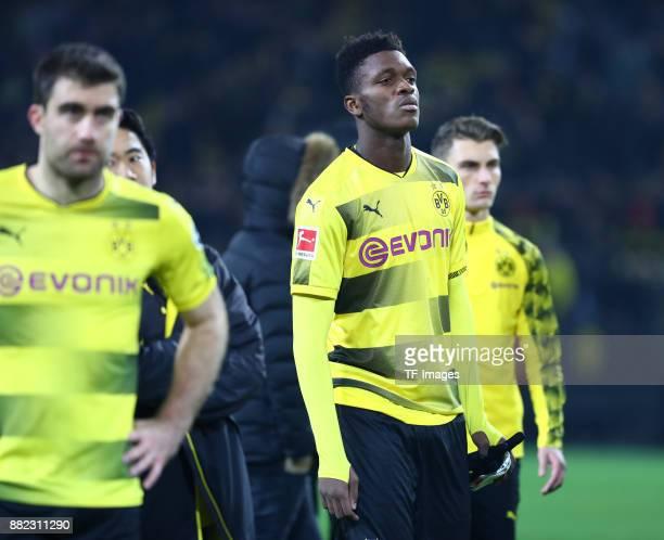 Sokratis Papastathopoulos of Dortmund DanAxel Zagadou of Dortmund and Maximilian Philipp of Dortmund looks dejected during the Bundesliga match...