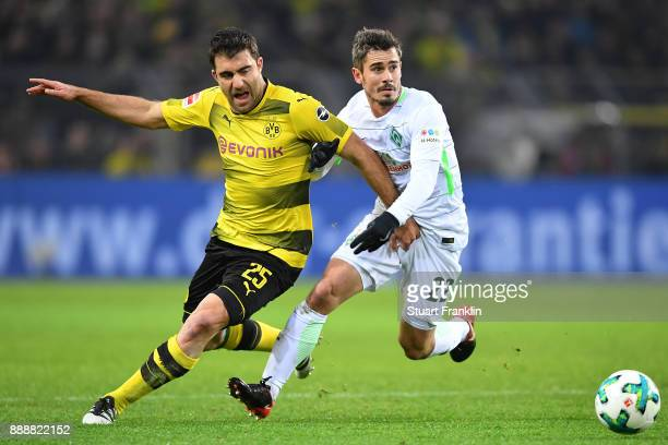 Sokratis Papastathopoulos of Dortmund fights for the ball with Fin Bartels of Bremen during the Bundesliga match between Borussia Dortmund and SV...
