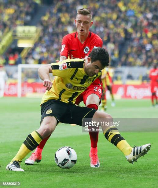 Sokratis Papastathopoulos of Dortmund is challenged by Marius Wolf of Frankfurt during the Bundesliga match between Borussia Dortmund and Eintracht...