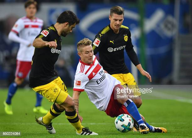 Sokratis Papastathopoulos of Dortmund Lewis Holtby of Hamburg and Lukasz Piszczek of Dortmund during the Bundesliga match between Hamburger SV and...