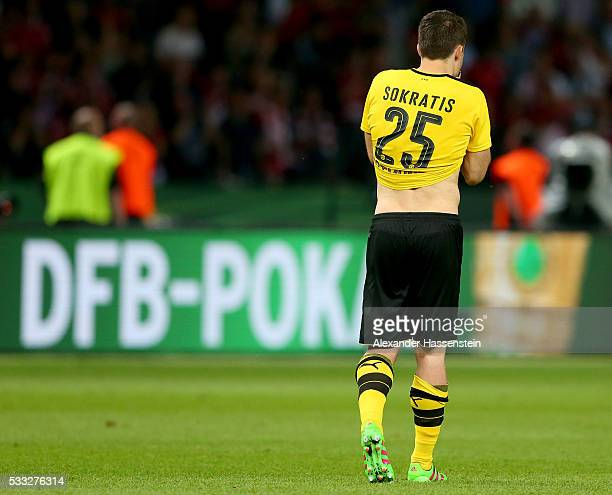 Sokratis Papastathopoulos of Dortmund looks dejected after missing a penalty during the DFB Cup Final penalty shootout between Bayern Muenchen and...