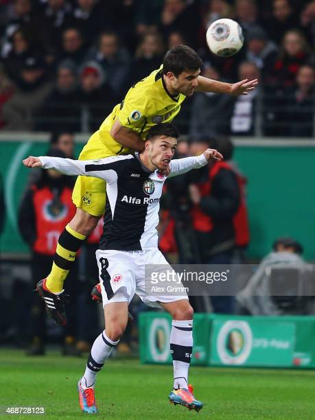 Sokratis Papastathopoulos of Dortmund outjumps Vaclav Kadlec of Frankfurt during the DFB Cup quarterfinal match between Eintracht Frankfurt and...