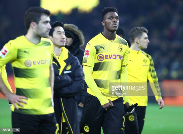 Sokratis Papastathopoulos of Dortmund Shinji Kagawa of Dortmund DanAxel Zagadou of Dortmund and Maximilian Philipp of Dortmund looks dejected during...