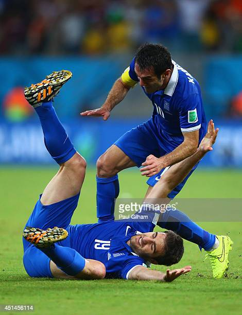 Sokratis Papastathopoulos of Greece celebrates scoring his team's first goal with Giorgos Karagounis during the 2014 FIFA World Cup Brazil Round of...