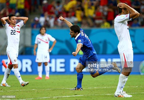 Sokratis Papastathopoulos of Greece celebrates scoring his team's first goal during the 2014 FIFA World Cup Brazil Round of 16 match between Costa...