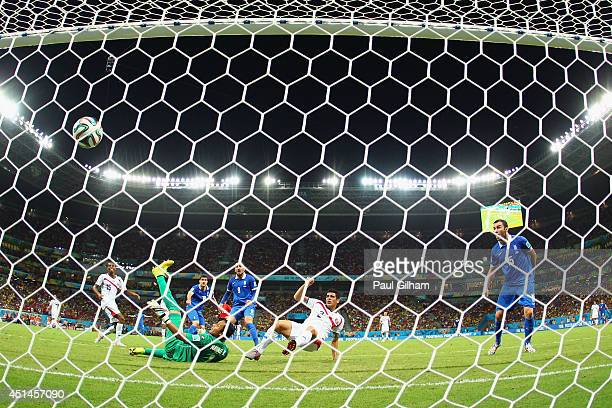 Sokratis Papastathopoulos of Greece scores his team's first goal past Keylor Navas of Costa Rica in stoppage time during the 2014 FIFA World Cup...