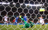 Sokratis Papastathopoulos of Greece shoots and scores past goalkeeper Keylor Navas of Costa Rica during the 2014 FIFA World Cup Brazil Round of 16...