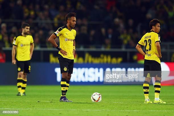 Sokratis Papastathopoulos PierreEmerick Aubameyang and Shinji Kagawa of Dortmund react after Aytac Sulu of Darmstadt scored his team's second goal...