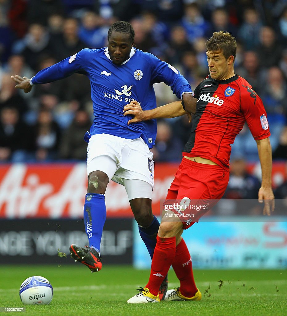 Sol Bamba of Leicester and <a gi-track='captionPersonalityLinkClicked' href=/galleries/search?phrase=Marko+Futacs&family=editorial&specificpeople=5964146 ng-click='$event.stopPropagation()'>Marko Futacs</a> of Portsmouth challenge for the ball during the npower Championship match between Leicester City and Portsmouth at The King Power Stadium on December 31, 2011 in Leicester, England.