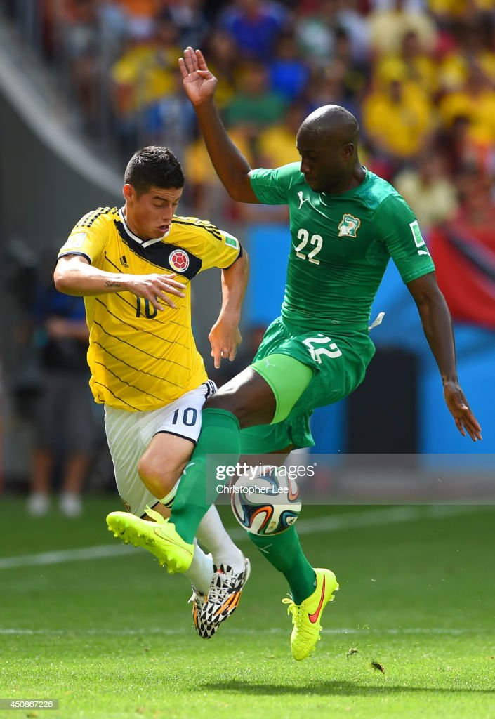 Sol Bamba of the Ivory Coast challenges James Rodriguez of Colombia during the 2014 FIFA World Cup Brazil Group C match between Colombia and Cote...