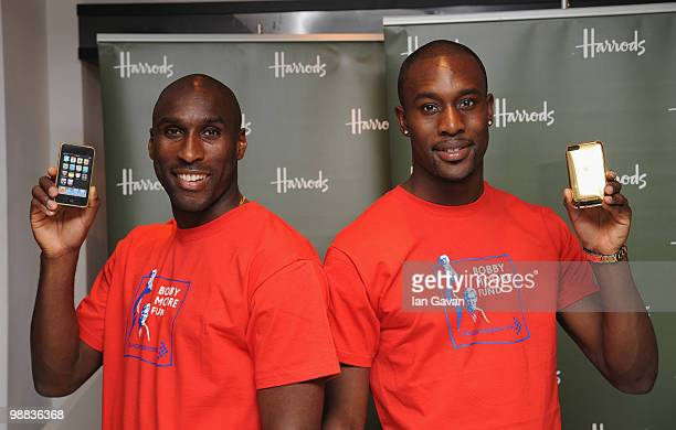 Sol Campbell and Carlton Cole attend a photocall to launch an exclusive ipod range in aid of the Bobby Moore Fund for Cancer Research at Harrods on...