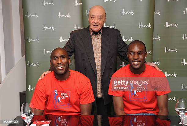 Sol Campbell Mohammed Al Fayed and Carlton Cole attend a photocall to launch an exclusive ipod range in aid of the Bobby Moore Fund for Cancer...