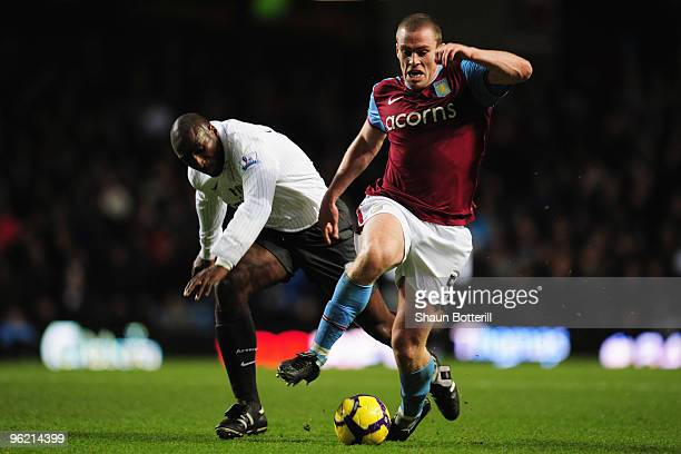 Sol Campbell of Arsenal challenges Richard Dunne of Aston Villa during the Barclays Premier League match between Aston Villa and Arsenal at Villa...