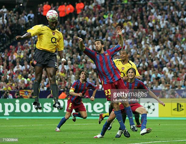 Sol Campbell of Arsenal rises above Presas Oleguer of Barcelona to score the first goal during the UEFA Champions League Final between Arsenal and...