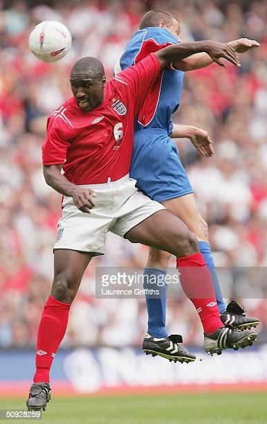 Sol Campbell of England battles with Helgi Sigurdsson of Iceland during The FA Summer Tournament match between England and Iceland at The City of...