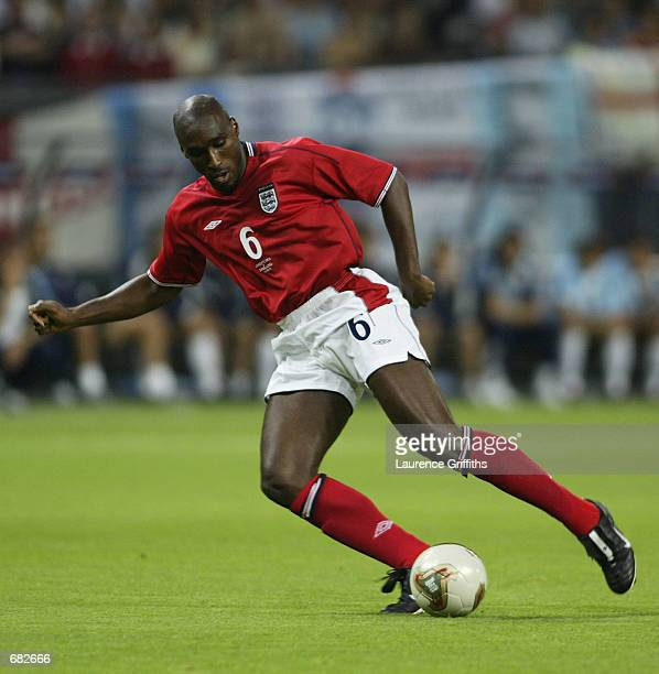Sol Campbell of England runs with the ball during the FIFA World Cup Finals 2002 Group F match between England and Argentina played at the Sapporo...