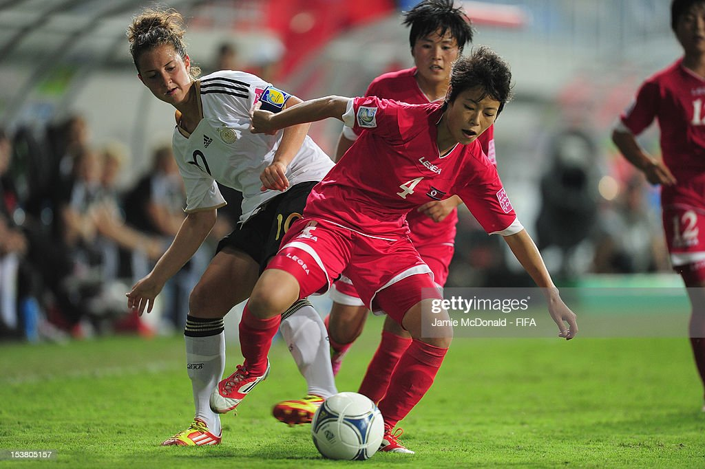 Sol Gyong Choe of Korea DPR battles with Sara Daebritz of Germany during the FIFA U-17 Women's World Cup 2012 Semi-Final match between Korea DPR and Germany at the 8KM Stadium on October 9, 2012 in Baku, Azerbaijan.