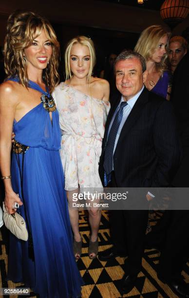 Sol Kerzner and actress Lindsay Lohan with Heather Kerzner attends the grand opening night of the Kerzner Mazagan Beach Resort on October 31 2009 in...