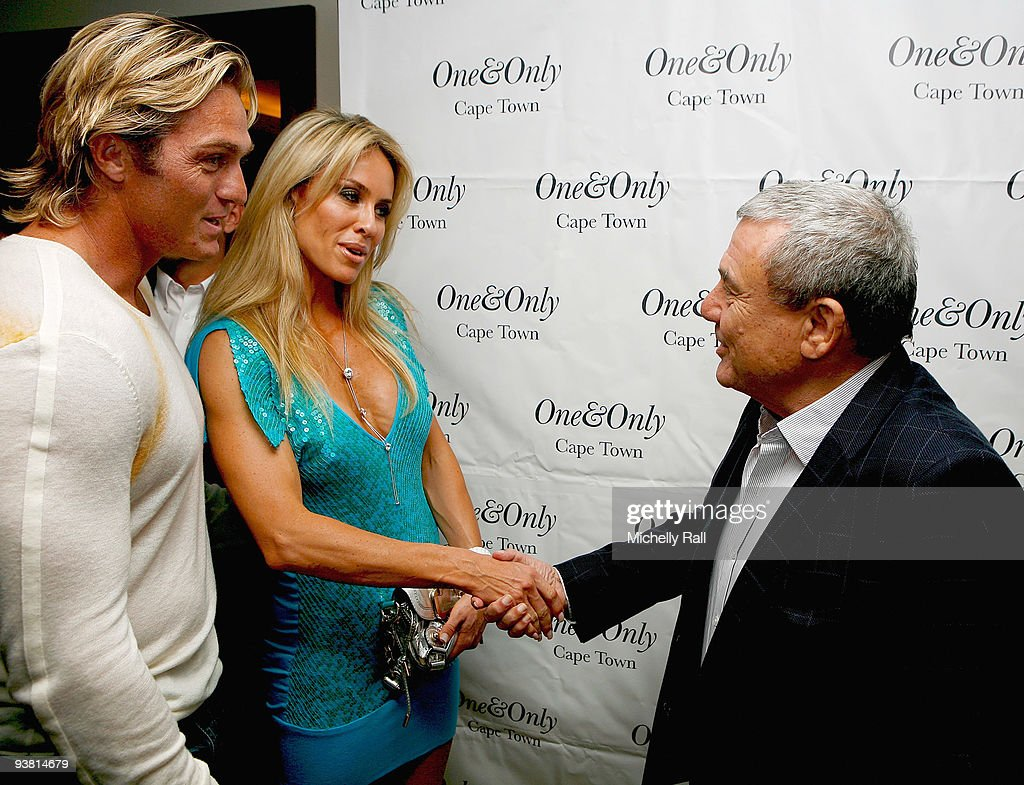Sol Kerzner greets Percy Montgomery and his wife Tasmin Montgomery at the FIFA World Cup 2010 Miss World Photocall at the One and Only Hotel on...