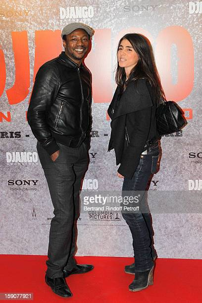 Solaar and Olivia Sabah attend a photocall for 'Django Unchained' at Le Grand Rex on January 7 2013 in Paris France