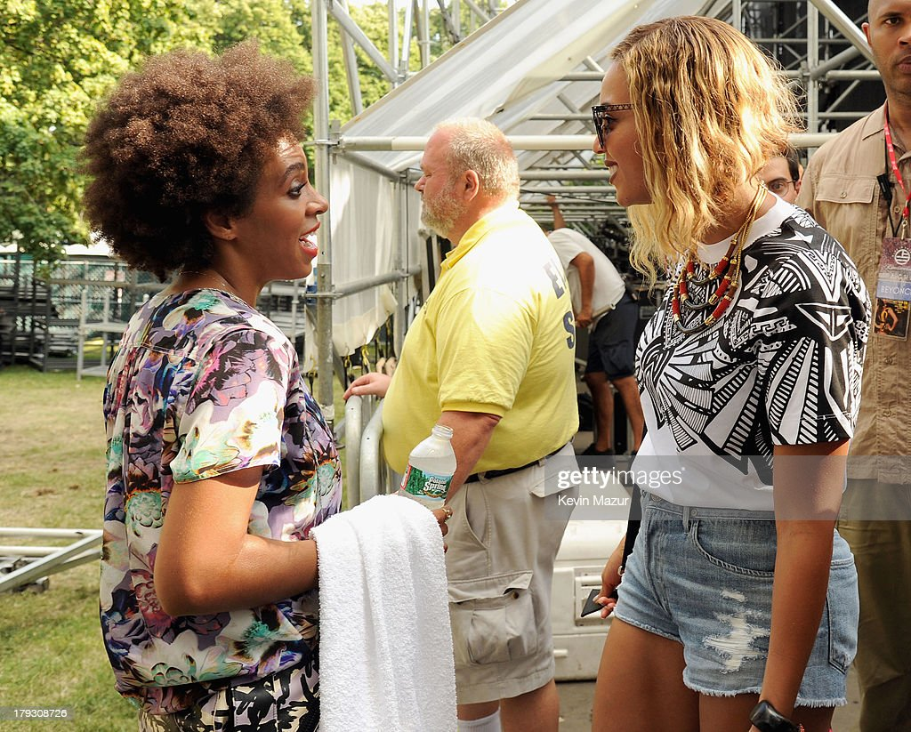 Solange (L) and Beyonce backstage during the 2013 Budweiser Made In America Festival at Benjamin Franklin Parkway on September 1, 2013 in Philadelphia, Pennsylvania.