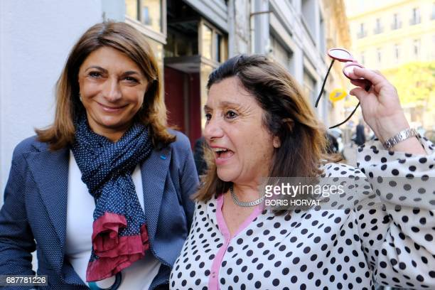 Solange Biaggi French rightwing Les Republicains party candidate in the fourth district of the BouchesduRhone department speaks to Martine Vassal...