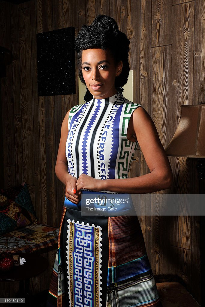 <a gi-track='captionPersonalityLinkClicked' href=/galleries/search?phrase=Solange+Knowles&family=editorial&specificpeople=221489 ng-click='$event.stopPropagation()'>Solange Knowles</a> wearing Mary Katrantzou poses at 'Better Days', an art bar installation by Mickalene Thomas presented by Absolut Art Bureau at Art Basel on June 12, 2013 in Basel, Switzerland.