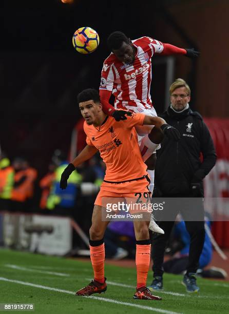 Solanke of Liverpool during with Mame Diouf of Stoke the Premier League match between Stoke City and Liverpool at Bet365 Stadium on November 29 2017...