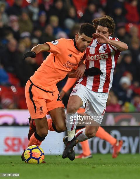 Solanke of Liverpool With Joe Allen of Stoke during the Premier League match between Stoke City and Liverpool at Bet365 Stadium on November 29 2017...